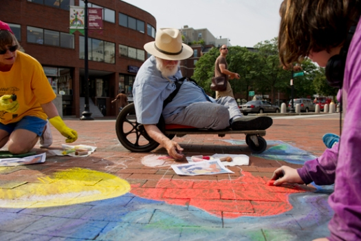 8/23/12 -- Cambridge, Massachusetts Popular sidewalk artist and Boston University alumni Sidewalk Sam creating his art in Harvard Square, Cambridge.. Photo by Melody Komyerov for Boston University Photography