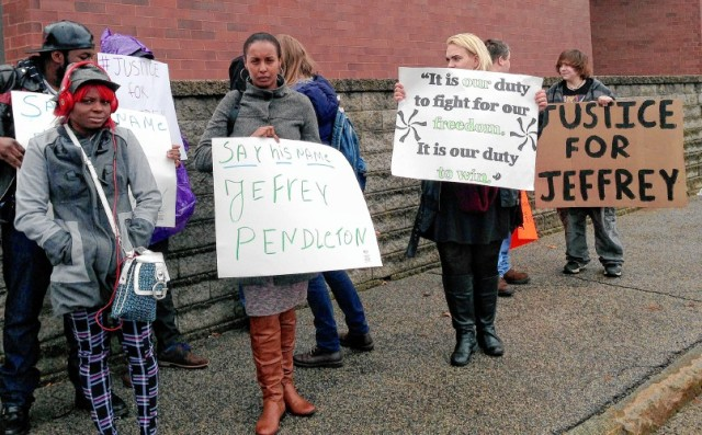 Activists and coworkers of Jeffrey Pendleton protest outside the Hillsborough County House of Corrections Friday, March 25, 2016, in Manchester, N.H., where he died Sunday after he was unable to post $100 bail. Jeffrey Pendleton, 26, was being held on a marijuana possession charge when he died Sunday. The Manchester Police Department is investigating Pendleton's death, and the state medical examiner's office says it is awaiting toxicology reports to determine the cause of death. (AP Photo/Kathleen Ronayne)
