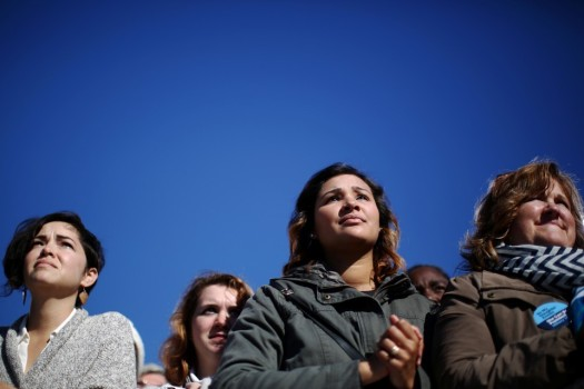 Women listening to President Obama campaign for HIllary Clinton in Ohio Photo from The Atlantic